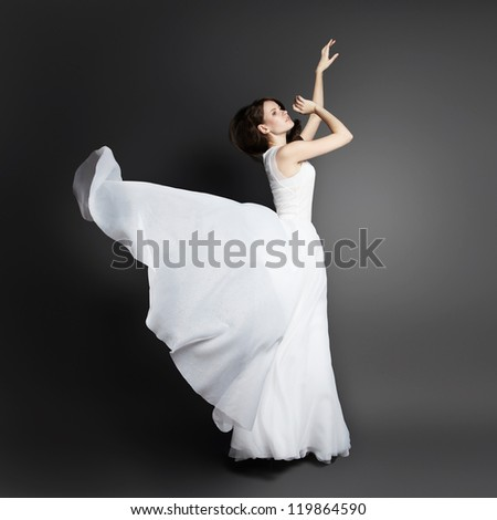 Romantic beautiful woman wearing white dress - stock photo