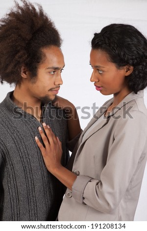 Romantic black couple, man  and woman, with eye contact and affectionately touching