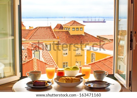 Romantic breakfast by window with a view in Lisbon, Portugal - stock photo