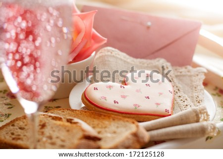 Romantic breakfast in bed. Breakfast tray with heart shaped biscuit, sparkling drink, rose and envelope. Perfect for Valentines, anniversary, birthday, wedding day or engagement.