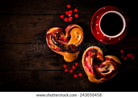 Romantic breakfast with heart shape jelly pastry and cup of coffee on wooden background with blank space  - stock photo