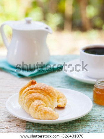 Romantic breakfast with love. Croissants, coffee, juice, wooden hearts. summer background. Copy space