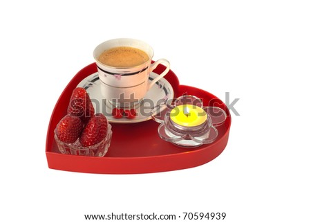Romantic breakfast with strawberries on red heart shaped tray with small candle