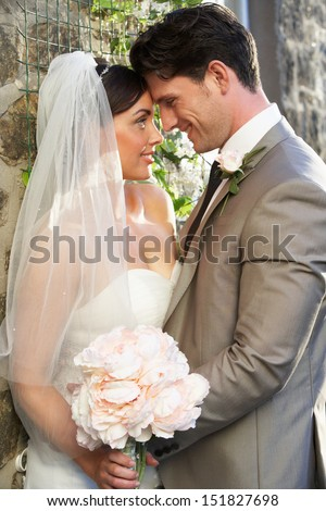 Romantic Bride And Groom Embracing Outdoors - stock photo
