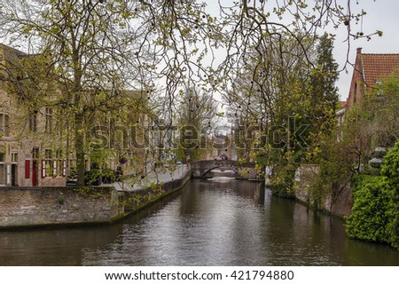 Romantic canal in Bruges historic center, Belgium - stock photo