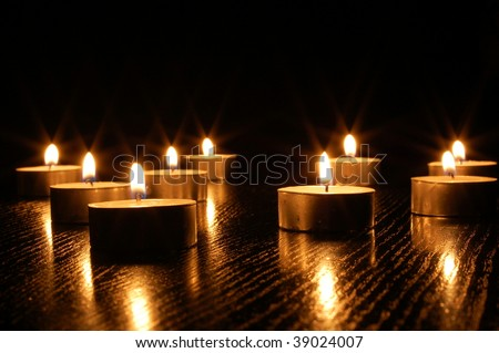 romantic candle light on a black background - stock photo