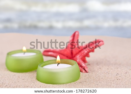 romantic candle set on the beach