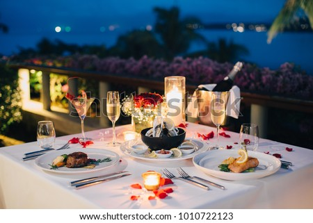 Romantic candlelight dinner table setup for Valentine\u0027s day with Ch&aign \u0026 wine glasses and special dishes & Romantic Candlelight Dinner Table Setup Valentines Stock Photo ...