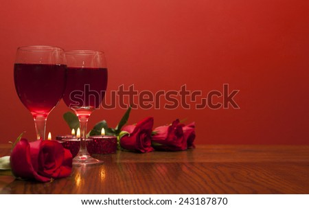 Romantic card for  Valentines day a glasses of vine with red roses and candles  - stock photo