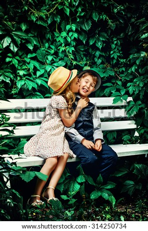 Romantic children at a park. Retro style. - stock photo