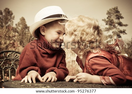 Romantic children at a park. Retro style. - stock photo