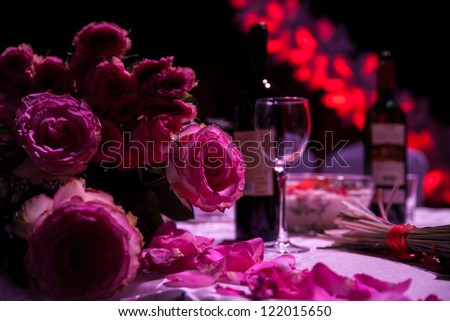 Romantic composition of roses and red wine on a background. - stock photo