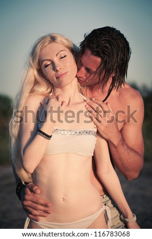 Romantic couple at the beach. - stock photo