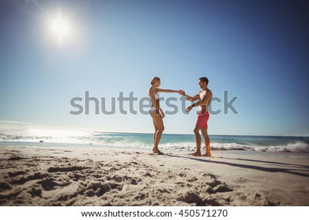 Romantic couple dancing on beach in summer