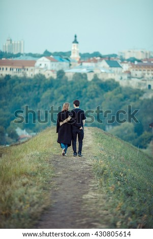 Romantic couple dating at the ancient castle.