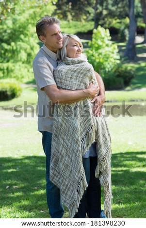 Romantic couple embracing in park
