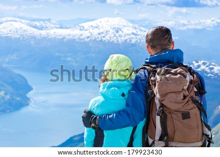 Romantic couple enjoing the view high in the mountains. Norway - stock photo