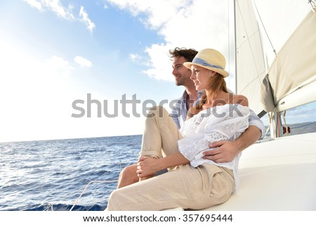Romantic couple enjoying sail cruise on Caribbean sea - stock photo