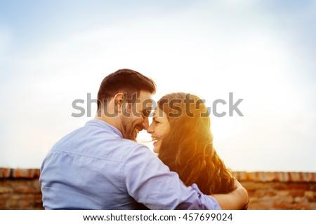 Romantic couple eskimo kissing outdoors