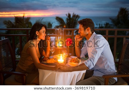 Romantic couple have dinner with sunset and candlelight outdoor, concept love, relationship and romantic  - stock photo