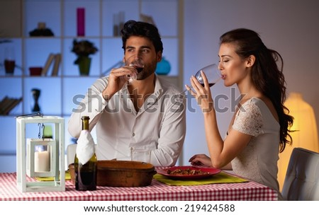 Romantic couple having dinner at home. - stock photo