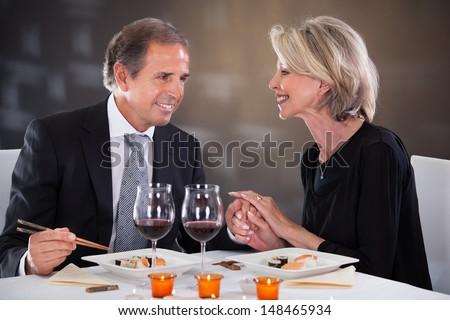 Romantic Couple Having Dinner At The Restaurant - stock photo
