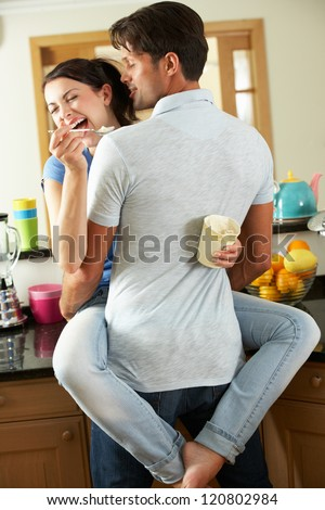 Romantic Couple Hugging And Eating Ice Cream - stock photo