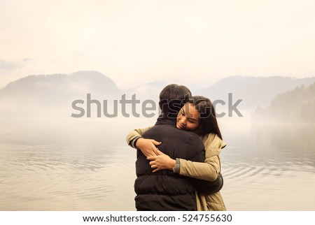 Romantic couple hugging by misty lake in autumn. Couple Hugging Stock Images  Royalty Free Images   Vectors