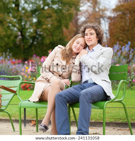 Romantic couple in a park, having a date