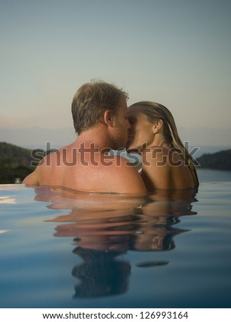 Romantic couple in infinity pool