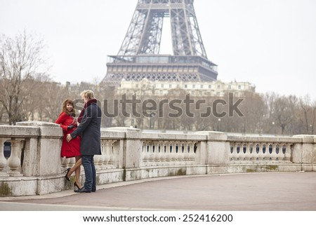 Romantic couple in love in Paris, near the Eiffel tower - stock photo