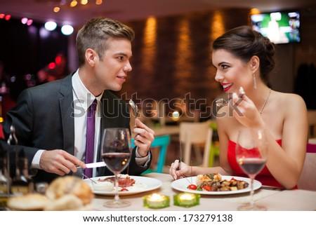 romantic couple in love on dinner in restaurant - stock photo