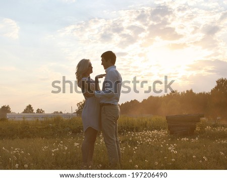 Romantic couple in love summer evening sunset - stock photo