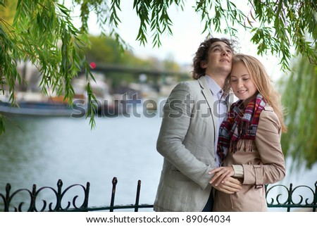 Romantic couple in Paris at spring, having a date - stock photo