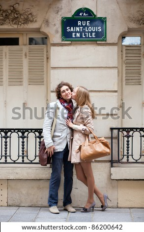 Romantic couple in Paris on the St. Louis island