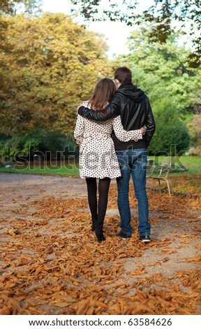 Romantic couple in the Luxembourg garden of Paris, walking - stock photo