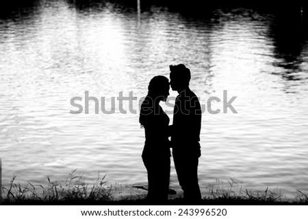Romantic couple kissing Black and White - stock photo