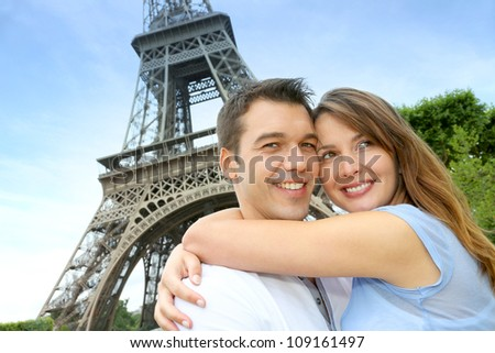 Romantic couple kissing by the Eiffel Tower