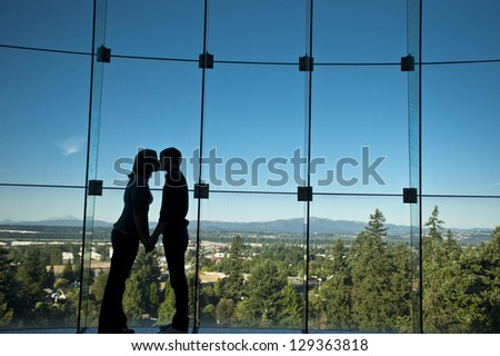 Romantic couple kissing in silhouette - stock photo