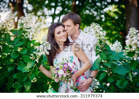 romantic couple kissing in the summer park.