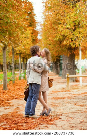 Romantic couple kissing on a beautiful fall day in Paris
