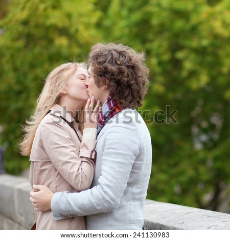 Romantic couple kissing outdoors