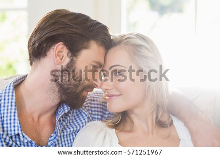Romantic couple looking face to face at home