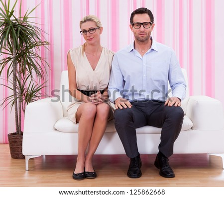 Romantic couple lovely couple at home sitting at sofa - stock photo