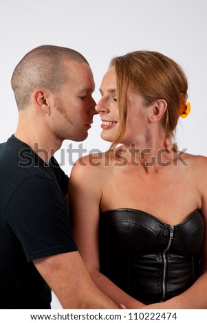 Romantic couple making out as he kisses her cheek and neck - stock photo