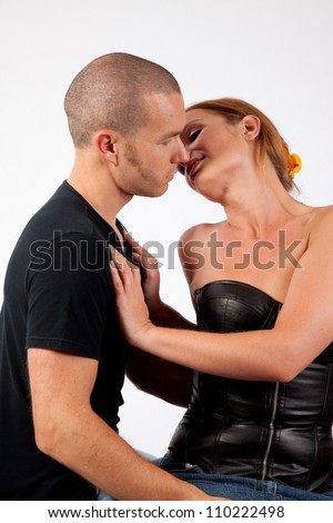 Romantic couple making out as he kisses her cheek and neck