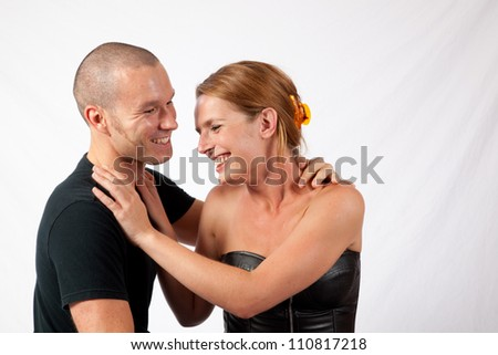 Romantic couple, man and woman sitting together and laughing with fun - stock photo