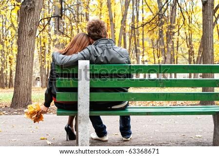 romantic couple on a bench - stock photo