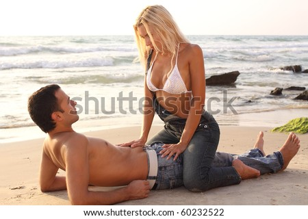 Romantic couple on a sand beach - stock photo