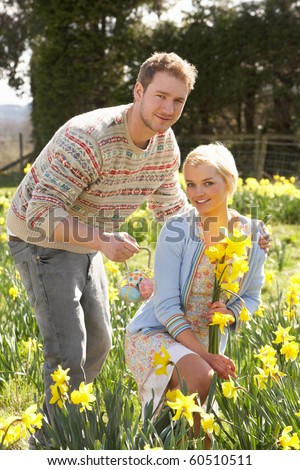 Romantic Couple Picking Spring Daffodils